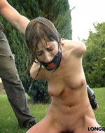 Longdozen - Gagged slave waited out in...