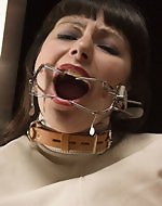Two lovely submissive girls are caged...