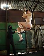 Brutally bullwhipped. Handcuffed...