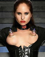 Andrea in latex corsette. Andrea M.,...