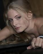 Sexy blonde in bondage. Claudie was...